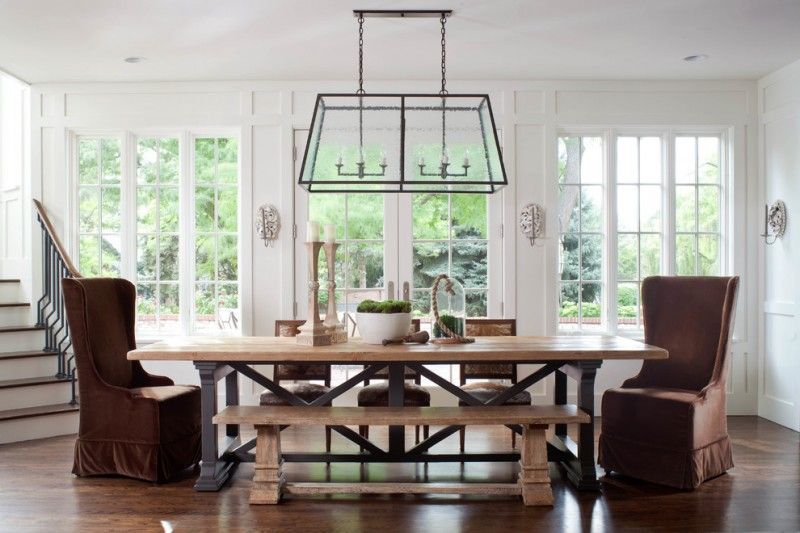 bench dining room table stairs chairs chandelier traditional style big windows