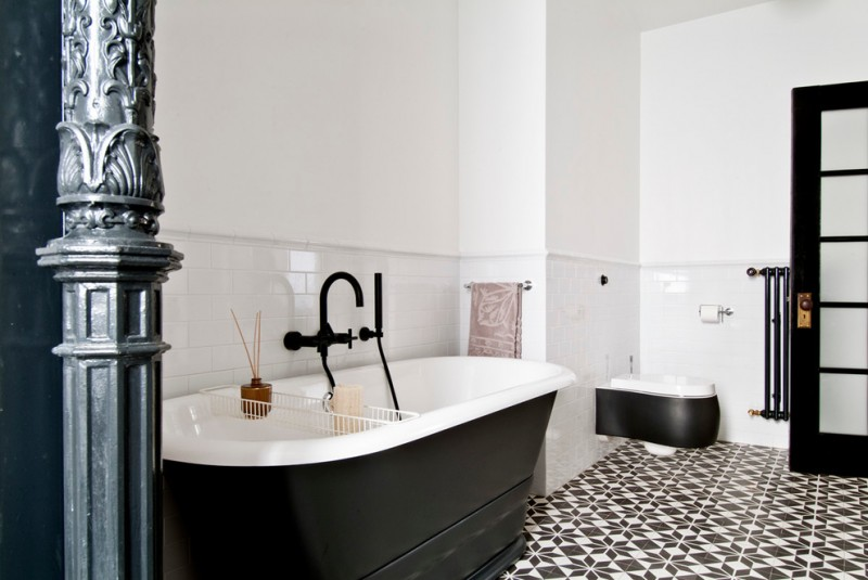 black and white tiles bath tub black tap black painted bathroom door white walls