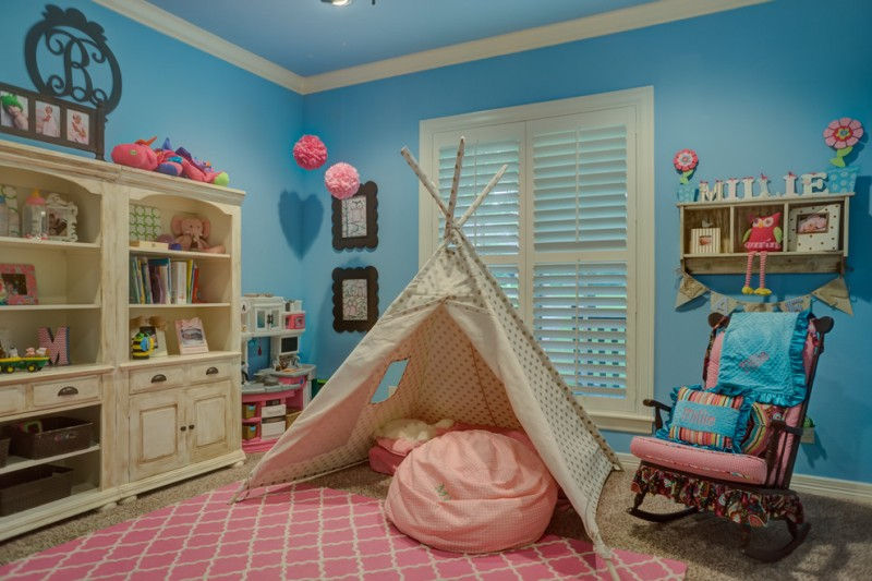 bright blue walls idea unfinished wood buffet for kids cream tent with darker brown polka dot motifs two layer carpet pink bean bag chair wood rocking chair for kids
