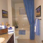 Ceiling Hung Shower Curtain Storage Item Towels Blue Paintings Bathtub Traditional Bathroom Towel Rack