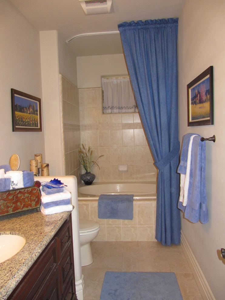 ceiling hung shower curtain storage item towels blue paintings bathtub traditional bathroom towel rack