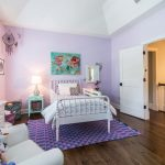 Charming Purple Walls Idea For Girls Room Traditional White Bed Frame With Headboard Purple Area Rug With Modern Motifs White Bedside Tables Dark Toned Wood Floors