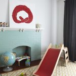 Clean White Walls With An Abstract Painting Decoration Blue Brick Fireplace For Storage Modern Carpet With Modern Patterns Kids' Playing Properties Made Of Wood