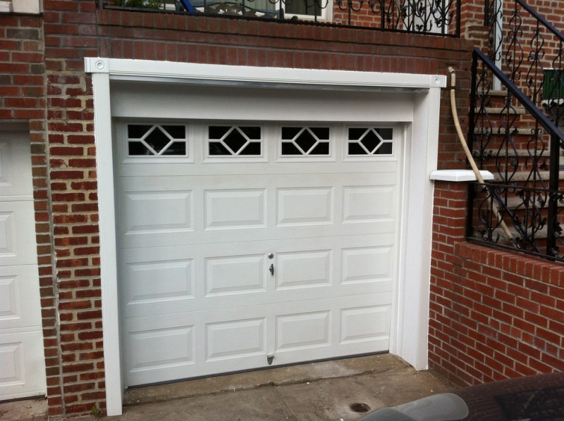 contemporary glass garage window PVC garage door red brick wall