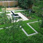 contemporary yard with large grass carpet, square pool with bridge, white grey path, plants groups on some spots
