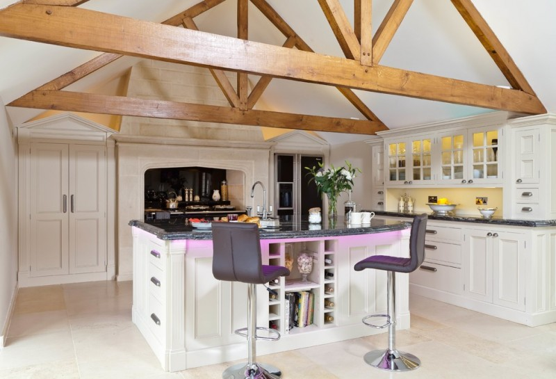 cool & spacious kitchen white cabinets white shaker cabinets black marble countertop white kitchen island with black marble top modern black stools with purple accent decorative logs for ceilin