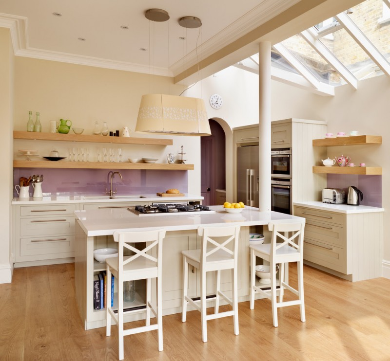 country kitchen idea with single countertop white cabinets open wood shelves glossy purple backsplash white kitchen island with white stools purple kitchen door light wooden floors