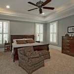Craftsman Wood Bed In Dark Wood Color Dark Wood Console In Classic Style Dark Wood Ceiling Fan Dark Toned Arm Chair Light Brown Area Rug Classic Style Wood Closet Storage