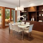 Dining Cabinet Shelves Wood Floor Glass Doors Chairs Table Contemporary Style Room Hanging Lamp Flowers Ceiling Lights