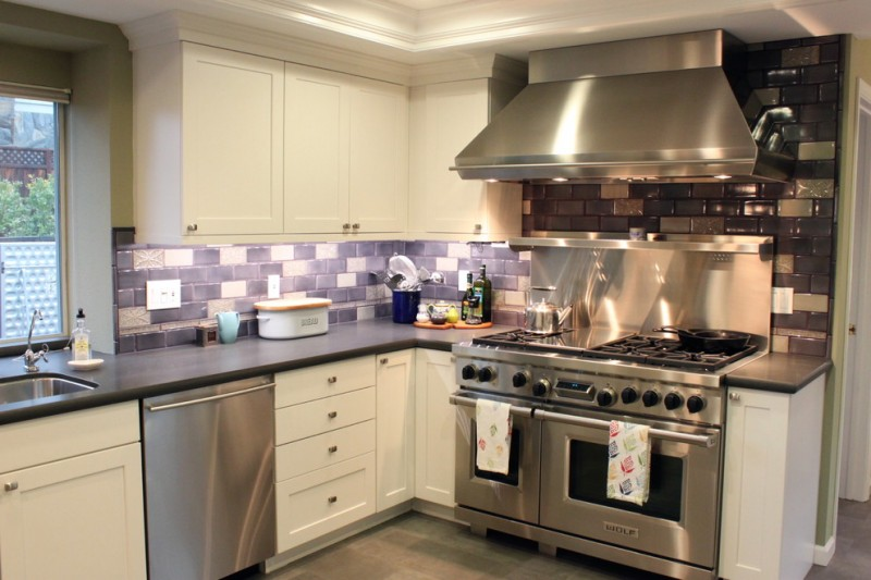 eclectic L shape kitchen idea with white purple subway tiles backsplash stainless steel appliances white cabinets stainless steel undermount sink and faucet