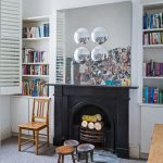 Eclectic Home Library With Black Painted Fireplace Wood Chair Three Small Round Chairs Recessed Bookcase With Under Cabinets Grey Area Rug