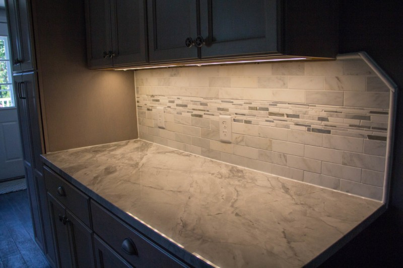 exodus white granite counter top working space dark cabinet tiled wall
