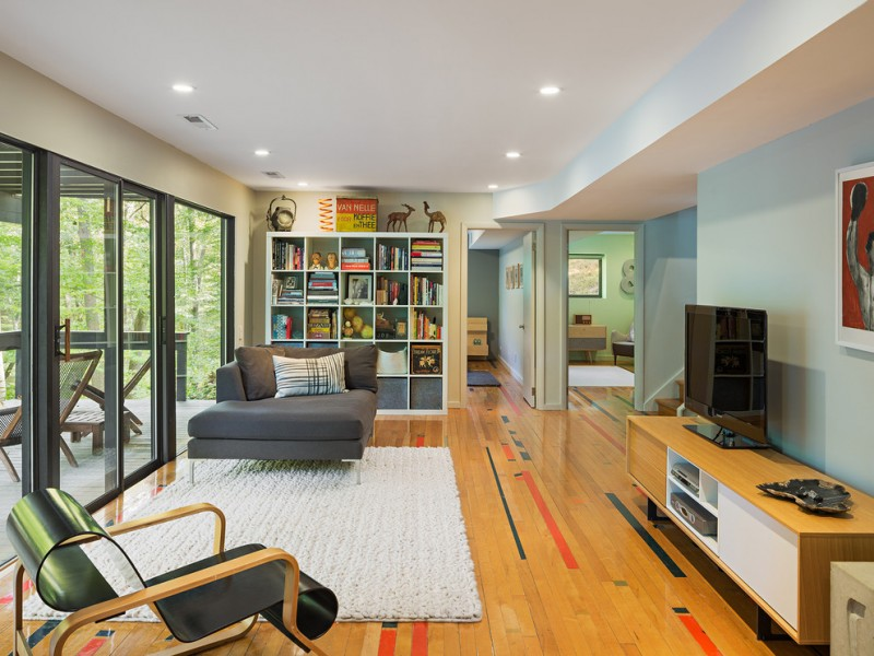 family room with reclaimed basketball court wooden for flooring