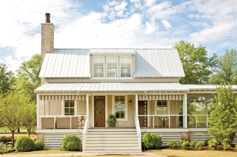 farmhouse exterior idea with white wood skirting stainless steel cable railings & white rail posts white exterior stairs hardwood entrance door and exterior glass windows