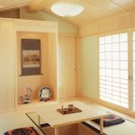 floor seating dining table tatami hanging lamps painting shoji door flowers asian dining room