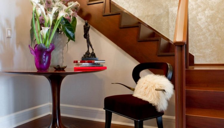 foyer round entryway table idea simple wooden chair foyer stairs flower vase mini statue