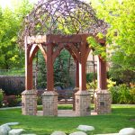 Gazebo With Ornate Round Ceiling, Iron Ornate Accesories, Wooden Poles, Bricks Foundation