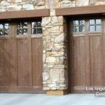 glass garage window wood beam wood garage door stone siding
