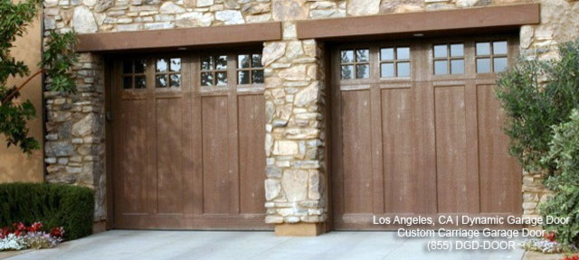 glass garage window wood beam wood garage door stone siding