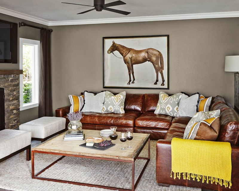 grey and yellow colours for tan leather couch in transitional living room for suburban oasis theme