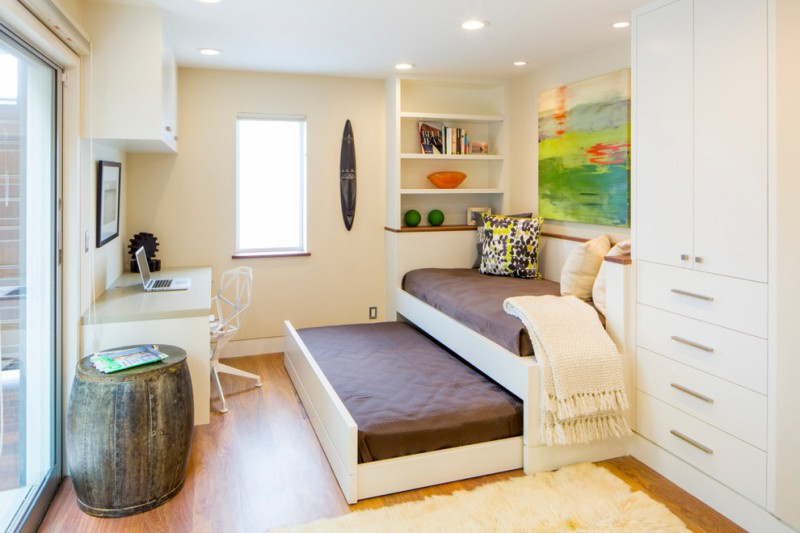 guest bed ideas carpet hardwood floor cabinet drawers window table laptop chair shelves daybed trundle pillows painting