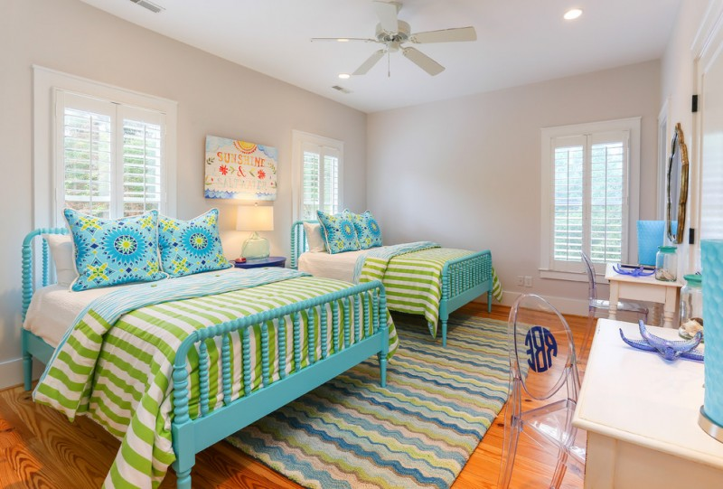 guest bed ideas wood floor transparent chairs big windows two lovely beds with blue frames pillows carpet ceiling fan lights painting tables