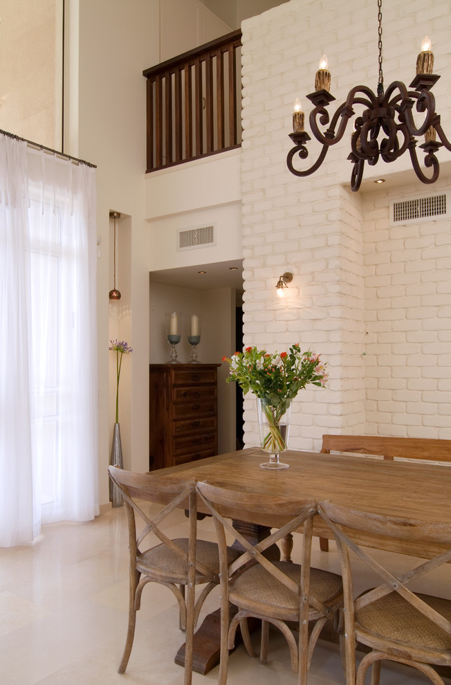 hardwood dining table and solid wood dining chairs in pale tone color clean white brick walls white floors