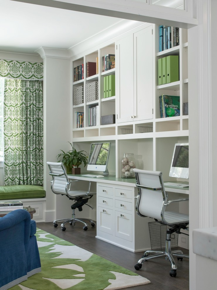 home office with dark wooden flooring, white top shelves and cabinet, white cabinet under the table, white chair, white green rug
