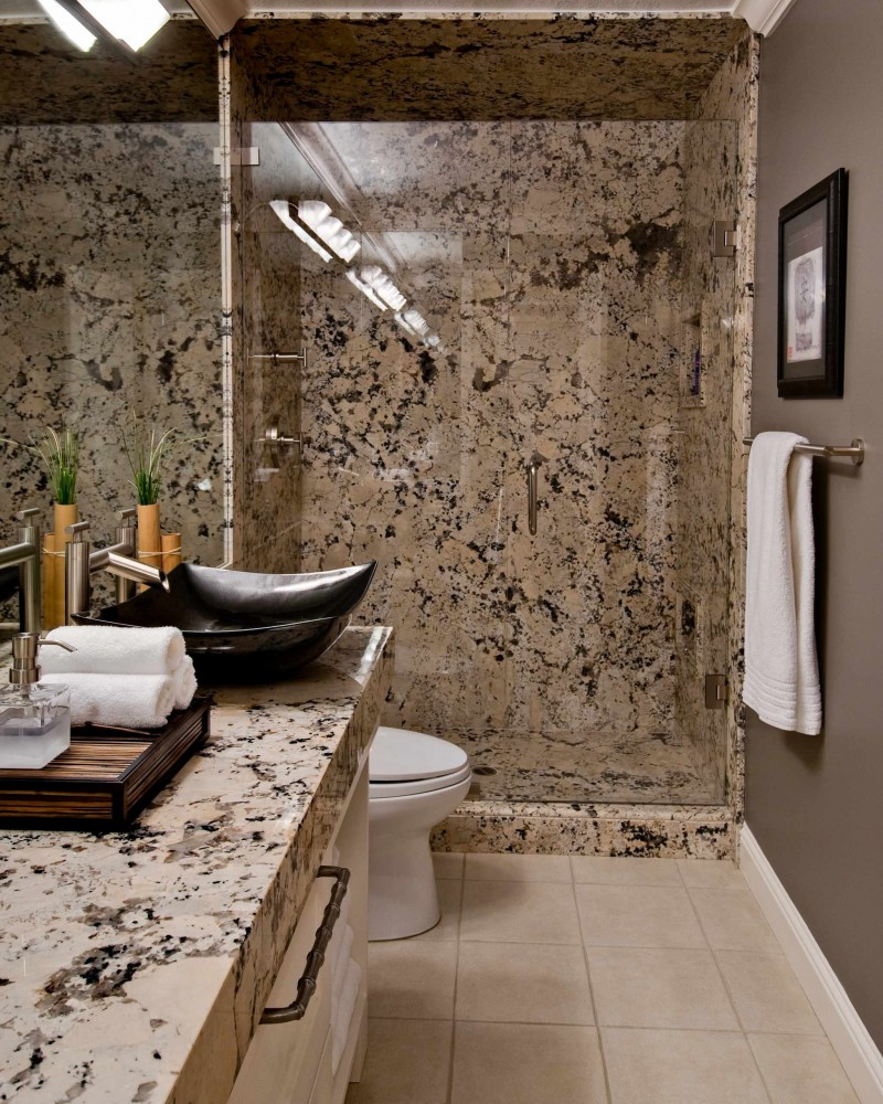 ice brown granite countertop brown granite wall glass shower door brown wall black floating sink