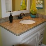 ice brown granite countertop white cabinet dark faucet white door undermount sink white mirror