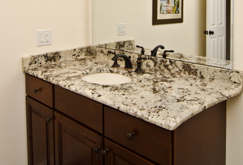 ice brown granite countertop wood cabinet dark faucet mirror undermount sink