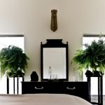 indoor planting idea victorian bedroom mirror storage item boston fern glasses bottle bed plants