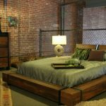 Industrial Wood Platform Bed Model With Two Separated Headboards Black Aluminum Nets Railing System As The Separated Red Bricks Wall System Green Area Rug With Traditional Motif