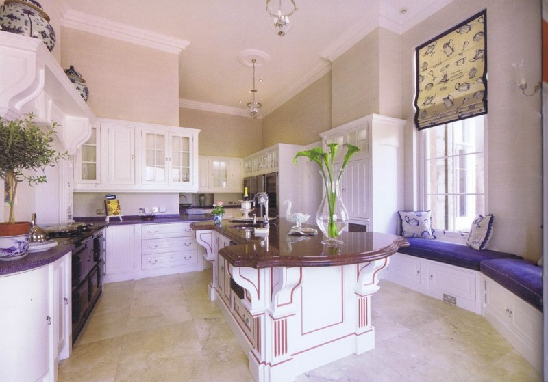 large traditional kitchen design with large kitchen island with purple top and decorative purple lines white cabinets white shaker cabinets purple countertop stainless steel appliances
