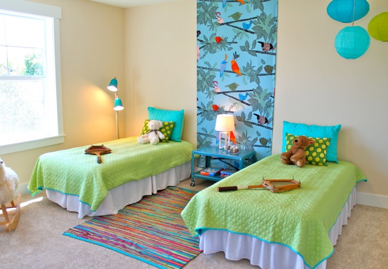 light beige walls idea a pair of bed with white slipcovers and green blankets bright blue bedside table dazzling stripes area rug colorful lantern pendant lamps blue wallpaper with nature theme