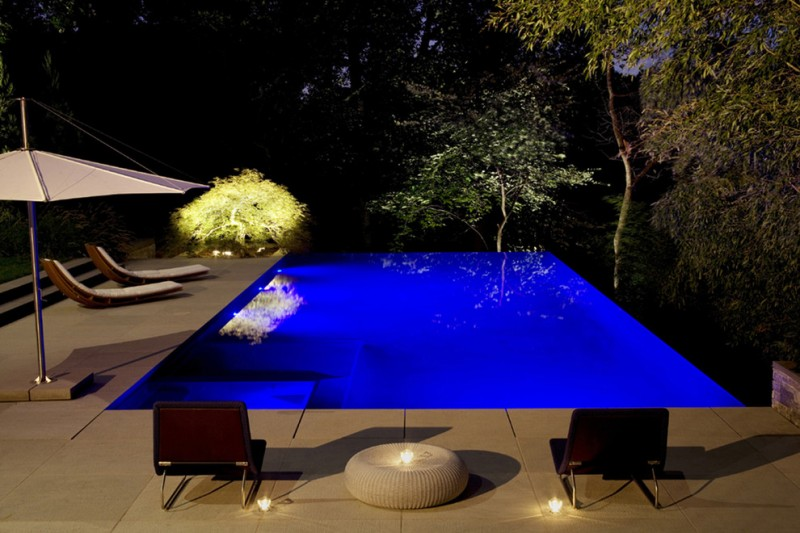 lighting built pool backyard sun umbrella white tiles lounge chairs pool