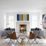living room scandinavian furniture austin fireplace white soft rug abstract colourful painting glass table standing lamp