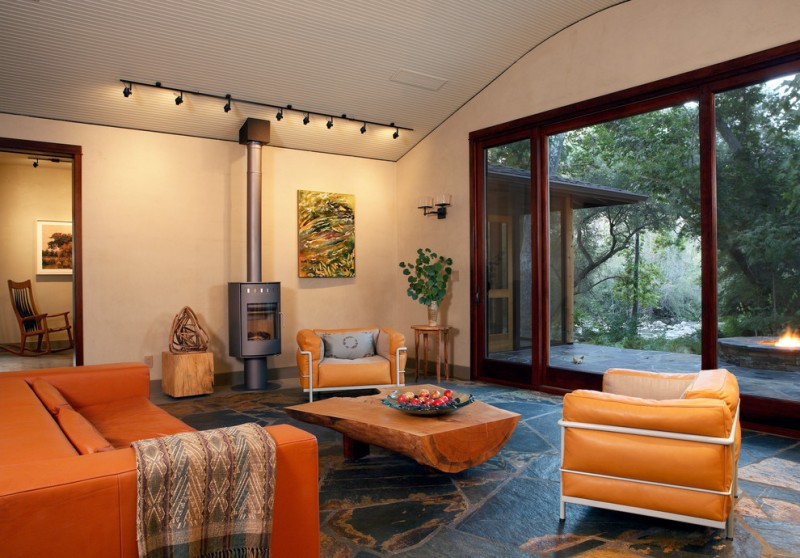 log cut coffee table bright orange chairs soapstone floors textured white ceiling small & metal fireplace wood side table