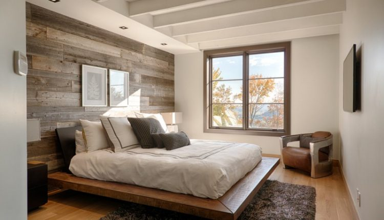 minimalist rustic wood platform bed frame idea with solid wood headboard in black fluffy & deep grey area rug cool shabby wood wall system light grey silver corner chair wood floors clean white walls