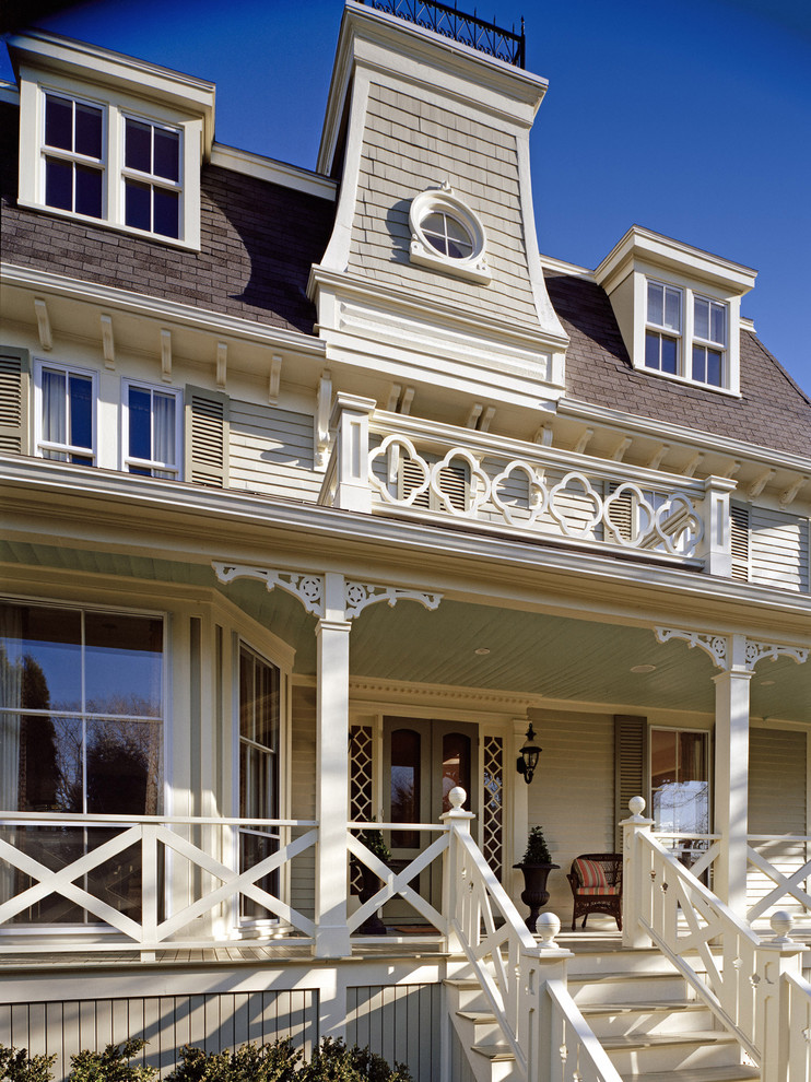 mix farmhouse victorian exterior idea with white wood skirting white railing system and stairs