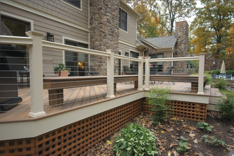 modern deck idea with stainless steel cable railing and white concrete rail posts cedar lattice house skirting in square shape cedar deck floors