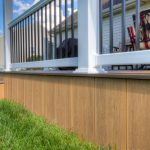 modern deck skirting idea which is made of hardwood with clear finishing modern style black wrought iron railing idea with white painted concrete rail posts