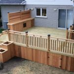 modern deck with cedar white pine skirting cedar rails idea grey brick walls glass exterior windows