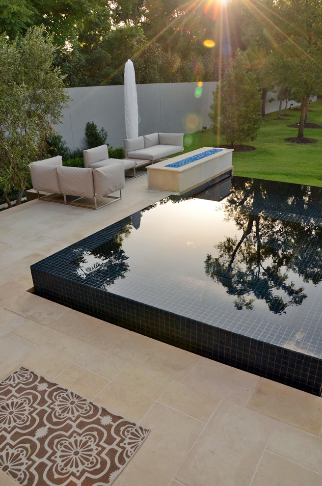 modern edge pool with blue tiles white tile floors white sofas