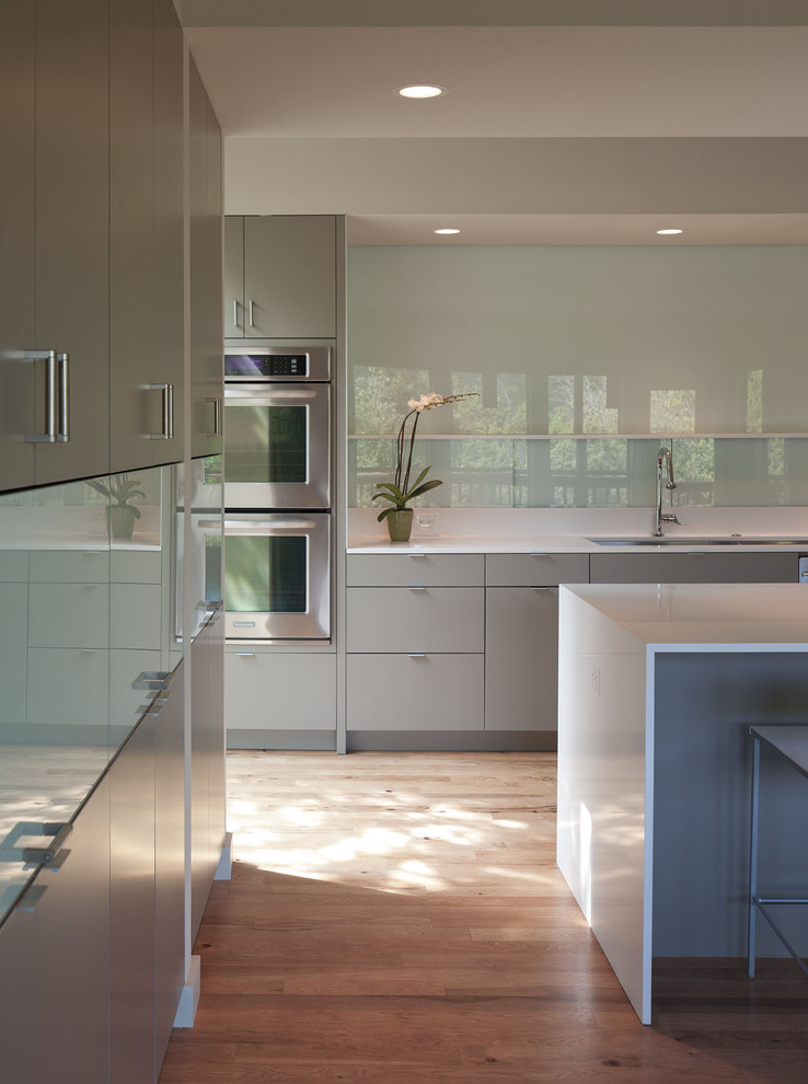 modern kitchen cupboard design hardwood floor glass surface drawers sink lights flowers