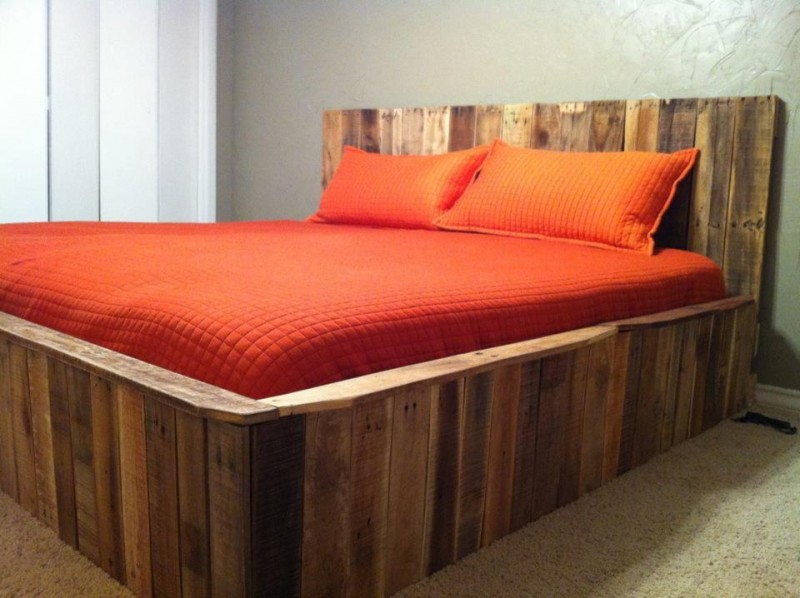 modern rustic wood bed design with headboard vividly orange bed linen and pillows