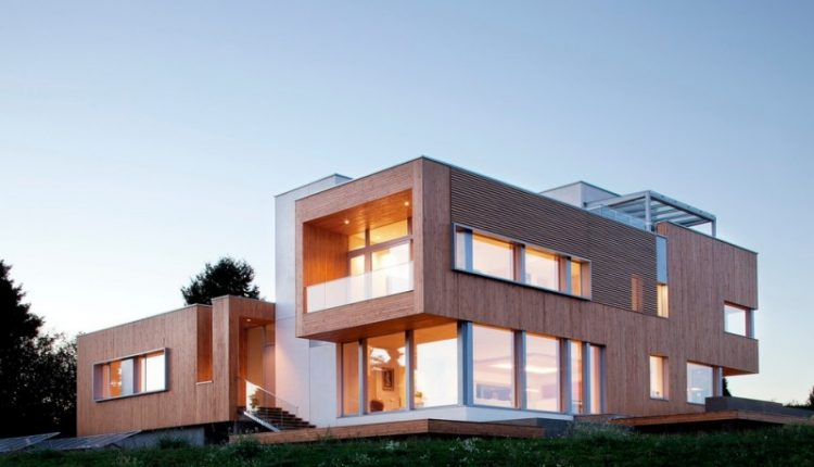 modern simple wood house trendy design contemporary exterior stairs windows grass impressive lighting