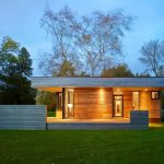 modern simple wooden house impressive lighting grass trees wood floor wall ceiling contemporary exterior