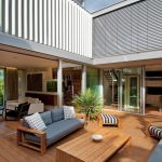 Modern Wood Deck Idea With Wood Siding Floors Wood Siding Center Table Wood Chairs With Soft Blue Comforter And Accent Pillows Two Wood Side Chairs With Monochromatic Stripes Comforter