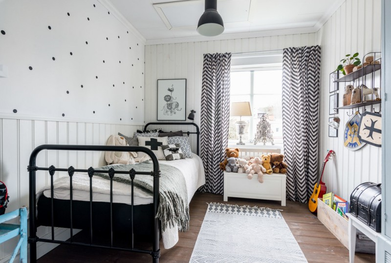 monochromatic walls for kids room black bed frame with headboard white traditional area rug dark toned wood floors white small bench for animal stuffs black iron shelves mounted on wall